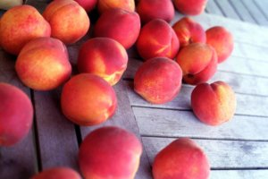 Peaches With Wooden Background